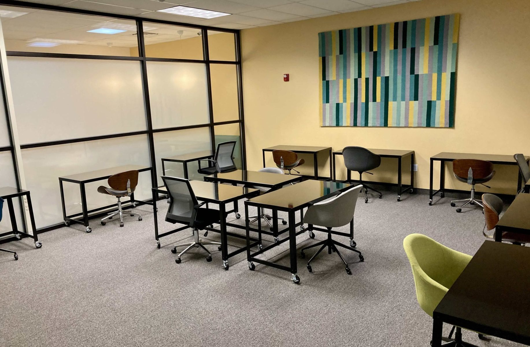The Quiet Room has many wooden tables and chairs in a large, open space.
